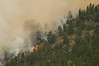 Photo by Walt Hester<br /> Flames and smoke leap up from the south slope of Bulwark Ridge on Tuesday. The Dunraven Fire west of Glen Haven started south of the Dunraven trail then jumped to the north side and up the ridge, burning within half a mile of homes on the ridge.