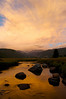 Photo by Walt Hester<br /> Sunrise paints clouds and, in turn, the Big Thompson River in Morain Park on Tuesday.