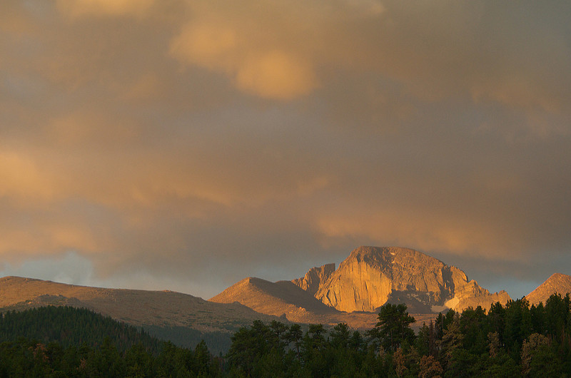 Photo by Walt Hester<br /> Storm clouds drift over Longs Peak and Rocky Mountain National Park on Tuesday morning.