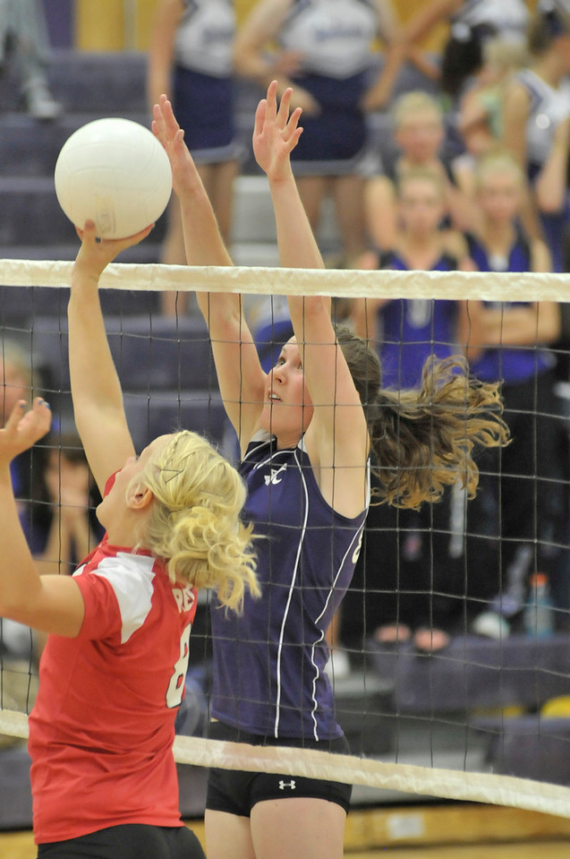 Photo by Walt Hester<br /> Faith Weible tries to block a Eaton dump on Tuesday. The Ladycats had little secccess against the Reds, losing the match 3-0.