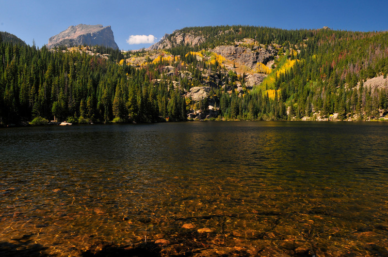 Photo by Walt Hester<br /> Blue sky and the start of fall color reflect off of Bear Lake on Wednesday.