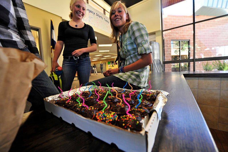 Photo by Walt Hester<br /> Sara Speedlin, right, receives cupcakes for her birthday on Monday.