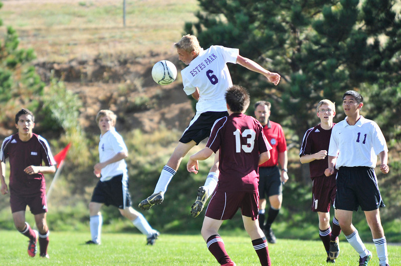Photo by Walt Hester<br /> Andrew Cirone elevates and heads a ball toward the Berthoud goal during Tuesday's showdown. Cirone scored one of the four Bobcats' goals.