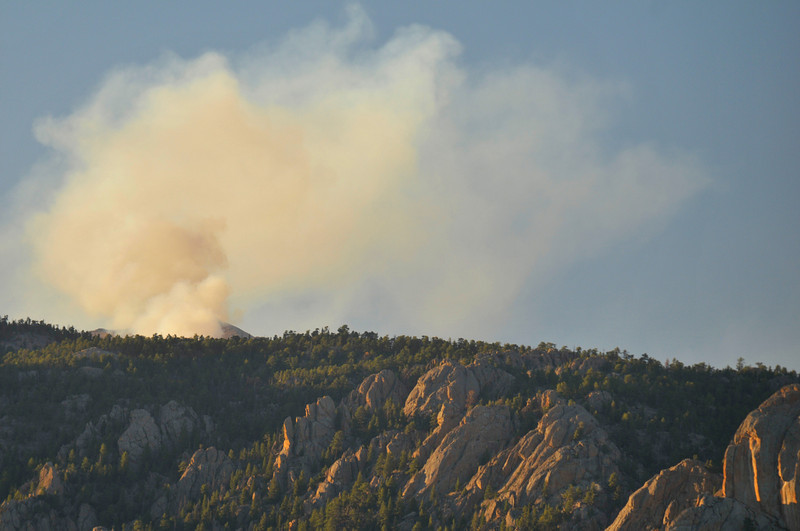 Photo by Walt Hester<br /> Thick smoke from the Cow Creek Fire climbs over Lumpy Ridge on Sunday afternoon. Hot dry weather also exacerbated a 40-acre fire on the west side of Rocky Mountain National Park that closed Trail Ridge Road and the Flattop Trail for a time on Sunday.