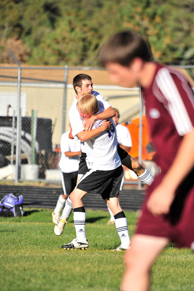 Photo by Walt Hester<br /> Dustin Hays celebrates the game winning goal with team mate Cole Thompson against Bethoud on Tuesday. The Bobcats remain undefeated after the 4-3 win.