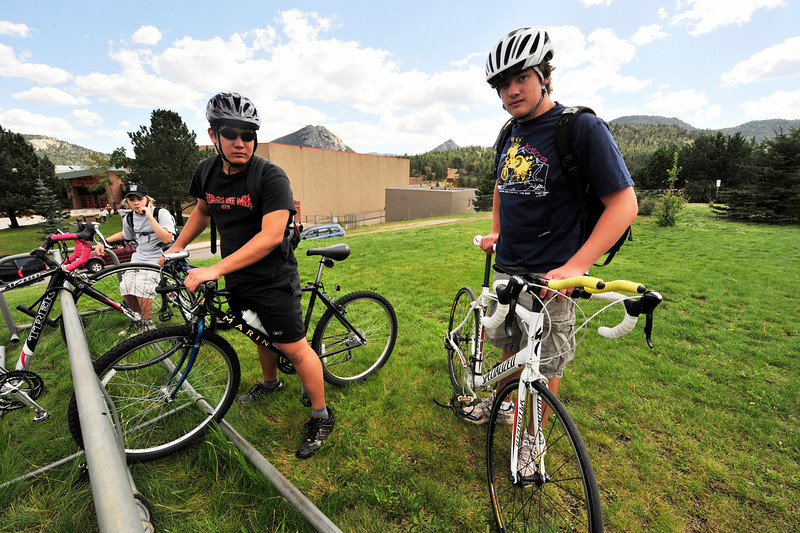 Photo by Walt Hester<br /> From right, Storm Wolf, Andrew Park and Alex Franklin mount up before leaving Friday's Freshman Orientation at the Estes Park High School. Like the Elementary School's open house, freshman were invited to the high school to get a look around to help find class rooms and meet teachers before the start of the school year.