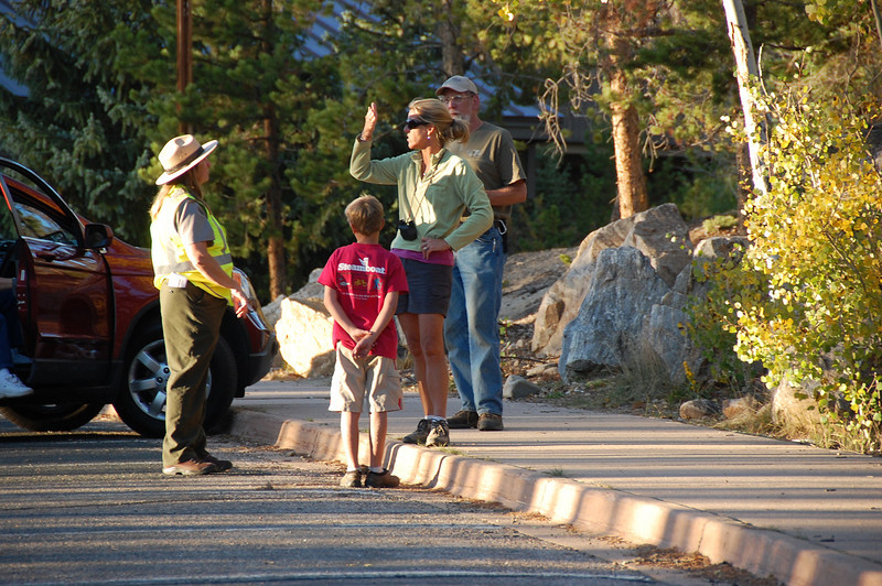 A park staffer talks with visitors stranded at the Kawuneeche Visitor Center Saturday afternoon. The Onoahu Fire prompted officials to close Trail Ridge Road Saturday afternoon.