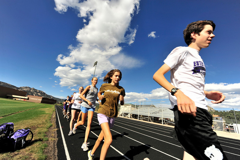 03EP Spts On The Run.jpg Photo by Walt Hester<br /> The Estes Park High School cross country team get a bit of track work in. Cross country runners use the track to get a better idea of the distance they are running.