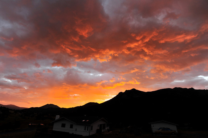 03EP News Sunrise.jpg Photo by Walt Hester<br /> Low clouds are painted by Tuesday's sunrise over Estes Park. Skies are expected to be clear for the last summer holiday weekend, with temperatures in the low 80s.