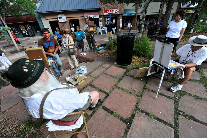 01EP View Painting Paul.jpg Photo by Walt Hester<br /> Artists huddle together to paint local resident Paul Saunders during the Plein Air Paint Out in Riverside Plaza on Saturday. The annual event gives artists the chance to paint locals, shops and the river on the plaza.