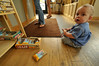 Photo by Walt Hester<br /> Nine-month-old Tristen Becker of Estes Park sorts through a box of energy bars at Kind Coffee on Saturday.