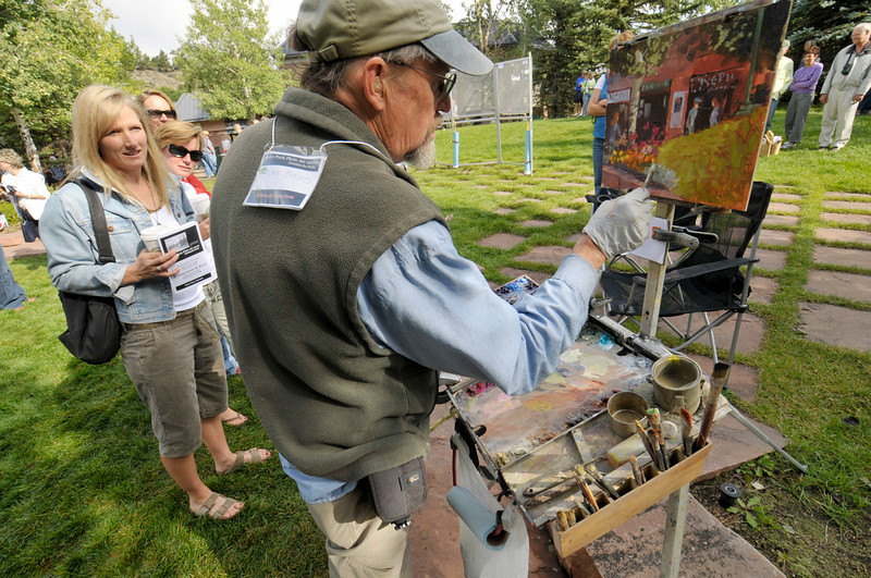 Photo by Walt Hester<br /> Local aspiring painters watch as Plein Air artist Dee Boyles puts the finishing touches on his 90-minute creation.