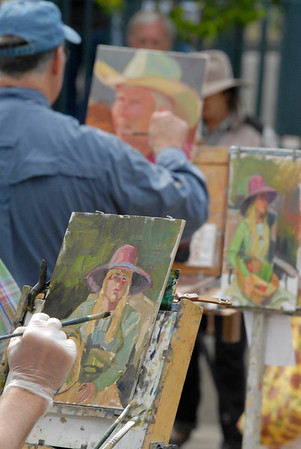 Photo by Walt Hester<br /> Artists lined up to paint models, scenes and still lifes in Riverside Plaza on Saturday.