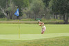 Photo by Walt Hester<br /> A golfer lobs a shot onto the green during a beautiful Saturday morning on the Lake Estes Public 9-hole course on Saturday.