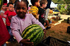 Photo by Walt Hester<br /> Elizabeth Miles, 3, happily hefts a water mellon at the Estes Valley Farmers' Market on Thursday.
