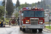 Photo by Walt Hester<br /> A new fire truck rolls into the arch of water powered by a 1901  Waterous steam fire pumper during a ceremony honoring the new equipment on Saturday. The town was invited to the Dannels Fire Station to see the new pumper, as well as the 108-year-old equipment, up close.