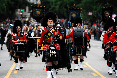 Photo by Walt Hester Denver's El Jebel Shriners' Pipe and Drum band marches down Elkhorn Avenue during the annual parade on Saturday. The El Jebel band is the oldest pipe and drum band in Colorado.
