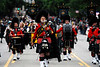 Photo by Walt Hester<br /> Denver's El Jebel Shriners' Pipe and Drum band marches down Elkhorn Avenue during the annual parade on Saturday. The El Jebel band is the oldest pipe and drum band in Colorado.