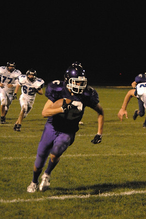 Photo by Walt Hester<br /> Sam Keller Twig gains yards after his 4th-quarter reception against Lyons on Friday night. The Bobcats lost their home opener to rival Lyons Lions 24-7.