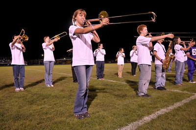 """Photo by Walt Hester Allison Rodgers, 15, performs with the Bobcats' Marching Band at halftime of Friday's football game at Bobcat Stadium. The band is building their 2009 competition routine based on the music of """"The Little Shop of Horrors."""""""
