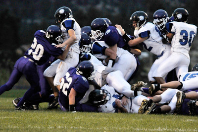 Photo by Walt Hester The Bobcats' defense showed some spark in the loss to Lyons.