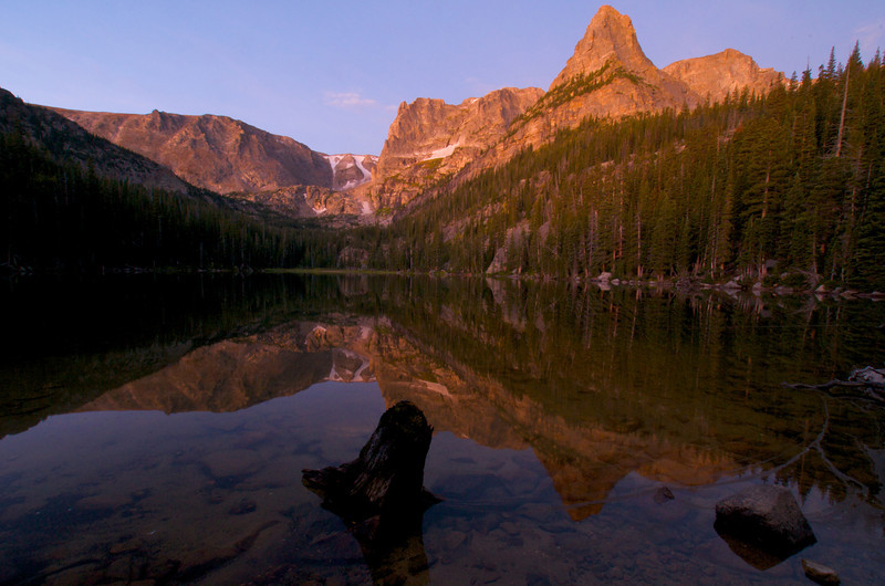 Photo by Walt Hester<br /> The faint coloring of the first morning light color Flattop, Notchtop and the Little Matterhorn above Odessa Lake on Thursday.