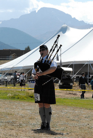 Photo by Walt Hester<br /> Molly Roberts of Erie, Colo., plays Piobaireachd tunes on the highland pipes during sos piper competition on Friday. Solo pipers , as well as bands, compete and march during the annual festival.