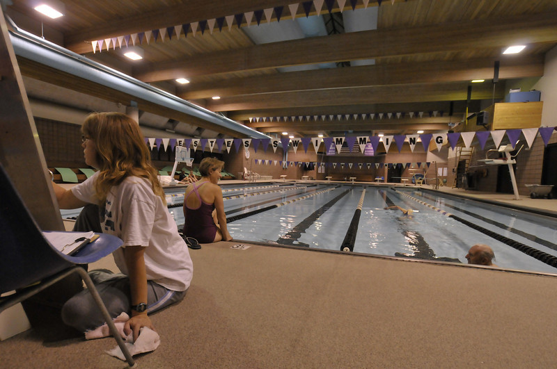 Photo by Walt Hester<br /> Early-morning swimmers slip in and through the water in the pre-dawn hours at the Estes Park Aquatic Center on Tuesday.