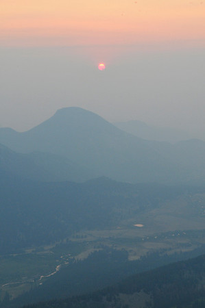 Photo by Walt Hester<br /> Haze from western wildfires obscures Tuesday's sunrise over Horseshoe Park. Fires on the Western Slope, Utah and as far away as California's Station Fire contributed to the haze.