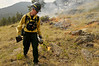 Photo by Walt Hester<br /> Mike Long of Grand Lake ignites brush with a drip torch in Upper Beaver Meadows on Tuesday. Rocky Mountain National Park fire crews set a prescribed burn to clear faster-burner fuels in the meadow in hopes of avoiding a catastrophic fire in the future. Photo by Walt Hester