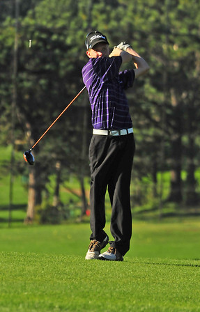 Photo by Walt Hester<br /> Bobcats' senior golfer Carson Joens knocks his tee, as well as his ball, down the first fairway at the opening of Thursday's home invitational tournament at the public 18-hole course. The Estes Park boys golfers hosted 25 other teams for the annual event.