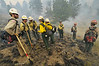 Photo by Walt Hester<br /> A fire crew in Rocky Mountain National Park awaits their next move during a prescribed burn on Tuesday. The park burned brush, grass and downed and dead trees during their operation on Monday and Tuesday.