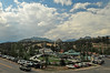 Photo by Walt Hester<br /> Clouds don't deter visitors from squeezing every bit of fun from summer at an amusement park in Estes Park on Sunday.