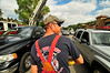 "Photo by Walt Hester<br /> Estes Park volunteer firefighter Kelly Wilkerson collects money for the Muscular Dystrophy Foundation in the middle of traffic on Elkhorn Avenue on Sunday. The annual ""Fill the Boot"" fund drive coincides with the MDA's Labor Day telethon."