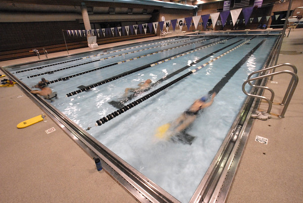 Photo by Walt Hester<br /> Swimmers take an early dip at the Aquatic Center on Tuesday. The pool has reopened after two weeks of annual maintenance and repainting.