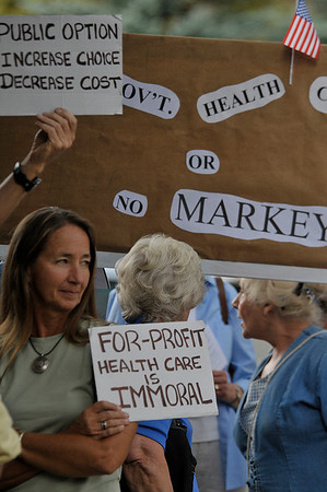 Photo by Walt Hester<br /> Anna Howlett holds her sign as she waits to enter the town hall meeting with Rep. Betsy Markey, D-Colo., on Thursday. Plenty of people brought signs expressing opinions on the state of health care to show Markey.