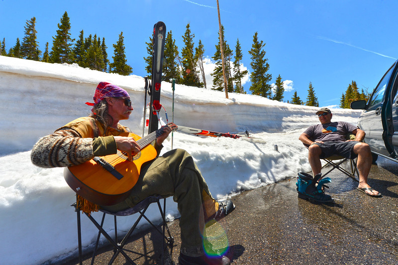 Summer skiers Karl Hudnut and Robert Sequeira both of Nederland take a break in a pullout along Trail Ridge Road on Friday. The road offers easy access to spring snow in Rocky Mountain National Park.