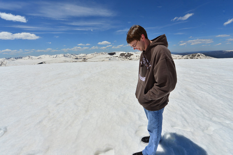 James McClay of Fairfax, Va., catches his breath on the Alpine Communities Trail above Trail Ridge Road on Friday. The road tops out at 12,183 feet above sea level.