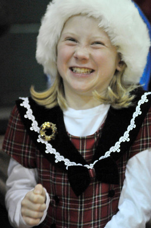Walt Hester | Trail-Gazette<br /> Fourth-grader Harlie Murray gets a giggle out of her class' holiday program on Thursday. The winter-theamed program had singing and jokes throughout.