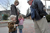 Walt Hester | Trail-Gazette<br /> Bell ringer Tom Anderson passes out treats to Ava, 2, Grace, 4, and Tamara Nydell in front of the Estes Park Post Office on Wednesday. The Salvation Army bell ringers are out and collecting, as well as giving, during December.