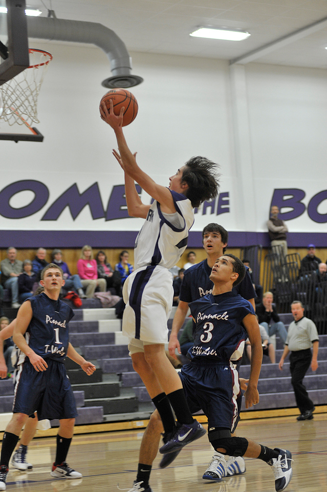 Walt Hester | Trail-Gazette<br /> Aaron Tulley flys to the basket to score two of his team-leading eight points on Monday. The Bobcats had a hard time scoring against the visiting Timberwolves.