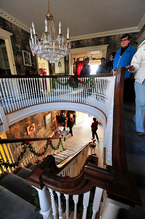 Walt Hester | Trail-Gazette<br /> Visitors inspect the staircase on Saturday that was once walked by F.O. Stanley. The home was one of several in the annual Quota Club Holiday Home Tour.