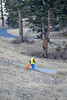 Walt Hester | Trail-Gazette<br /> A volunteer picks up litter below South St. Vrain Avenue nea Carriage Drive on Tuesday.