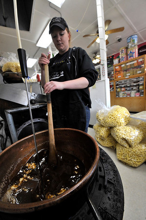 Walt Hester | Trail-Gazette<br /> Rebecca Nicholson stirs a mixture on Wednesday that will become caramel for caramel corn at Laura's Fudge. The concoction is mostly brown sugar and butter with some water and corn solids.