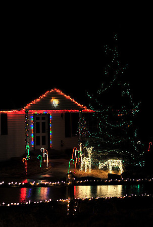 Walt Hester | Trail-Gazette<br /> A holiday display lights up a home along High Pine Drive on Friday. Holiday lights are out and ready for visitors in Estes Park.