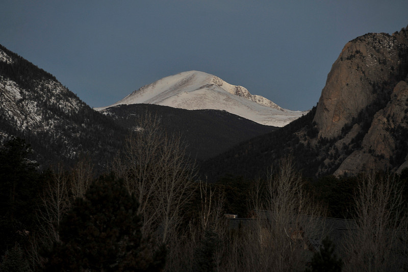 Walt Hester | Trail-Gazette<br /> A snow-caped mountain of the Mummy Range sticks up over Estes Park early Wednesday morning. Warm temperatures returned mid-week before snow is expected to return on Saturday.