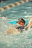 Walt Hester | Trail-Gazette<br /> Senior swimmer Brit Walters reaches for home in a good performance in the 50 yard backstroke during Saturday's season opening Estes Sprints. The Ladycats finished second behind rival Niwot, with 42 points, ahead of seven other schools.