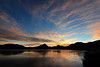 Walt Hester | Trail-Gazette<br /> Dawn colors clouds and ice on Lake Estes on Monday. Look for more sun than clouds toward the end on the week.