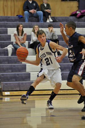 Walt Hester | Trail-Gazette<br /> Avi Weissman looks for an open teammate on Monday. Weissman came off the bench as a roll-player, according to the 'Cats' head coach, Chad Nachtrieb.
