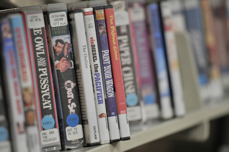 Walt Hester | Trail-Gazette<br /> VHS cassetts intermingle with newer DVDs at the Estes Valley Public Library on Tuesday. The old technolodgy will soon be removed as it is all but obsolete.